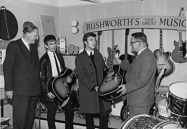 John Lennon and George Harrison receive their Gibson J160e